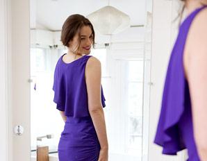 woman-looking-mirror-dress